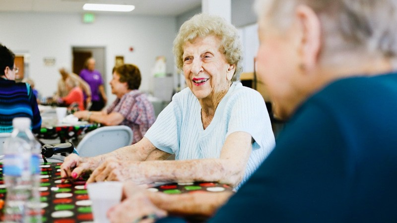 Some ladies at senior centers playing bingo