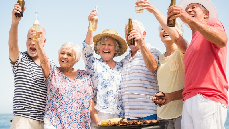 Group of seniors at a barbecue binge drinking