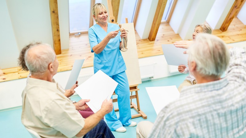 Nurse teaching art class in assisted living facility in Indiana