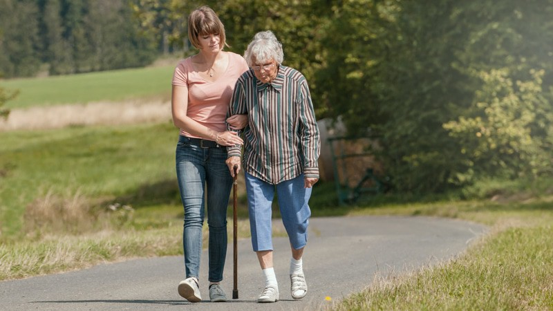 Caregiver experiencing Isolation walks with her mother