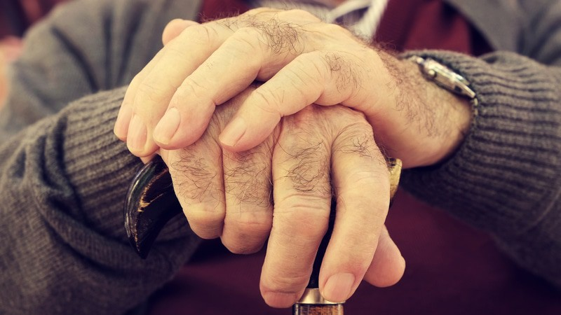 Man's hands in a memory care facility