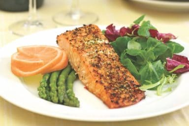 Orange glazed salmon that you can find at your local senior home