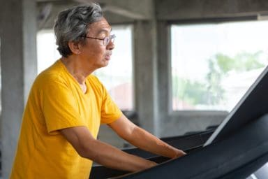 Senior man walking on treadmill
