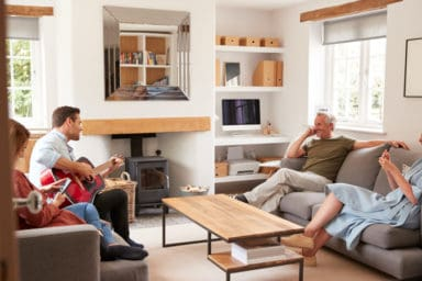 Adult son gives parents a private concert with his guitar while his wife ignores him