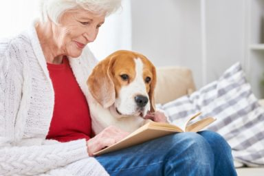 Loving Senior Woman Reading with Dog