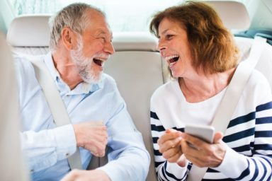 Stoned senior couple using ridesharing for the first time