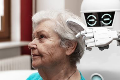 Care-bots brushing a seniors hair