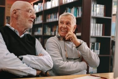Two senior men who want to learn something new even though they are old