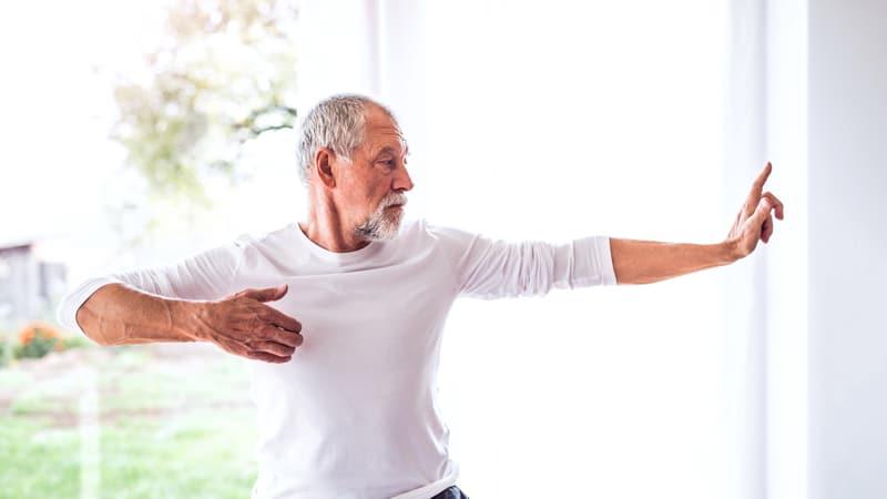 Senior man doing an indoor exercise regime