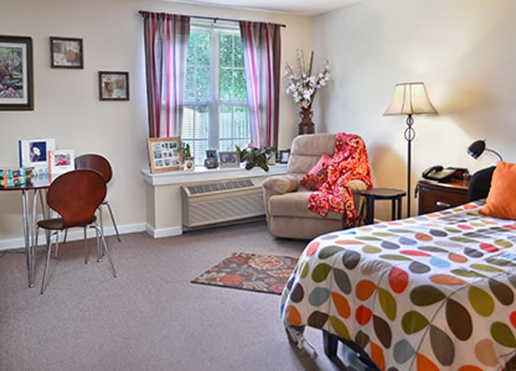 Cottage of Clayton Assisted Living Bedroom with chair and desk