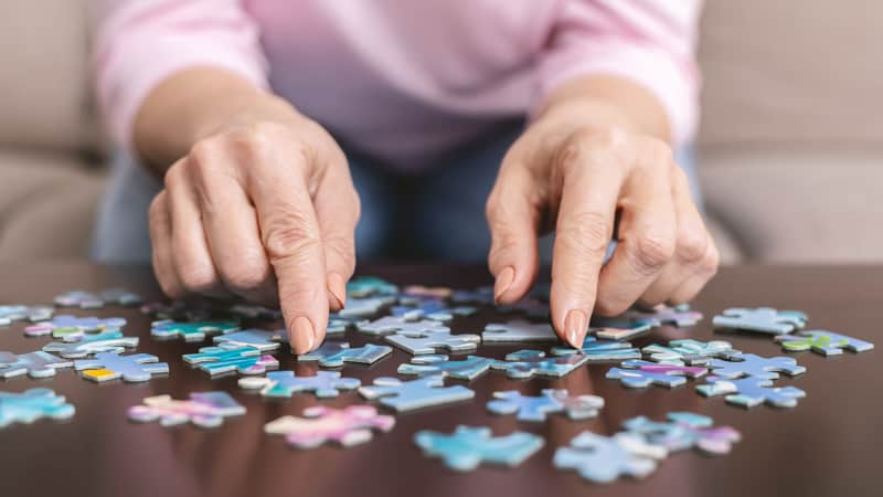 Woman doing a fun puzzle