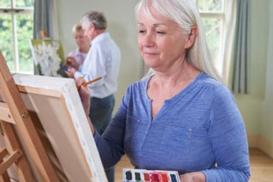 Senior enjoying the benefits of art