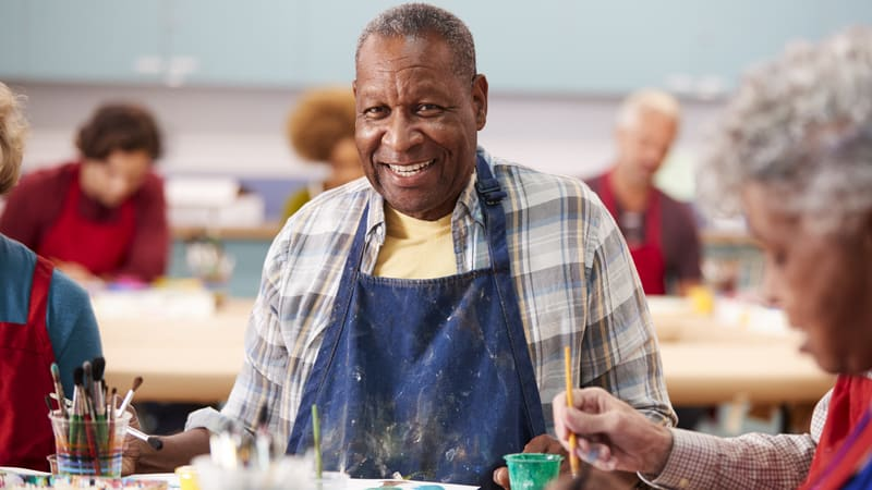 Man in art class at a CCRC