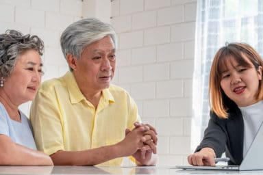 Senior Asian couple looking at retirement communities