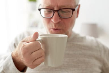 Senior man drinking coffee in his affordable senior living