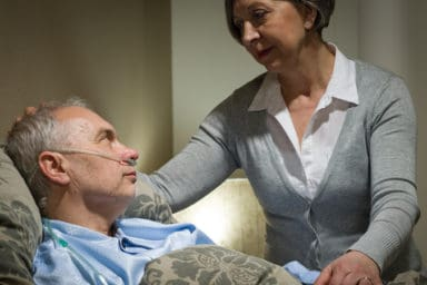 Senior caring for loved one diagnosed with COVID-19