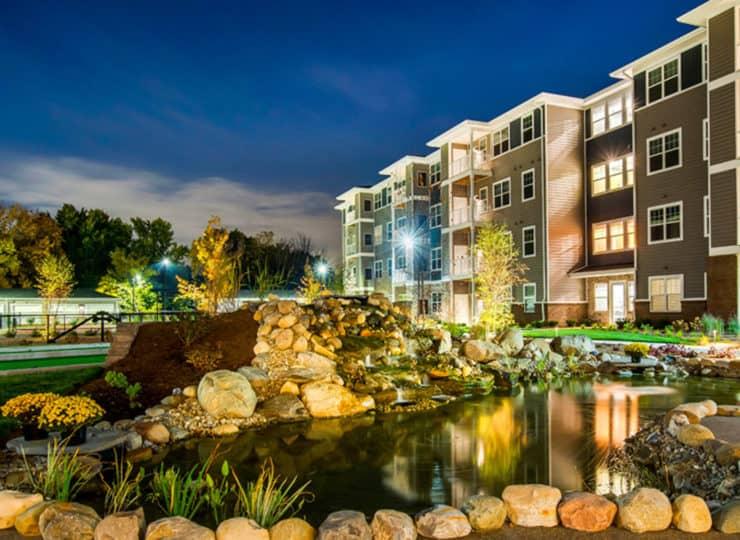 Encore Apartments fountain at twilight