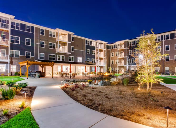 Encore Apartments courtyard at twilight