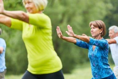 Seniors doing yoga in rehab care