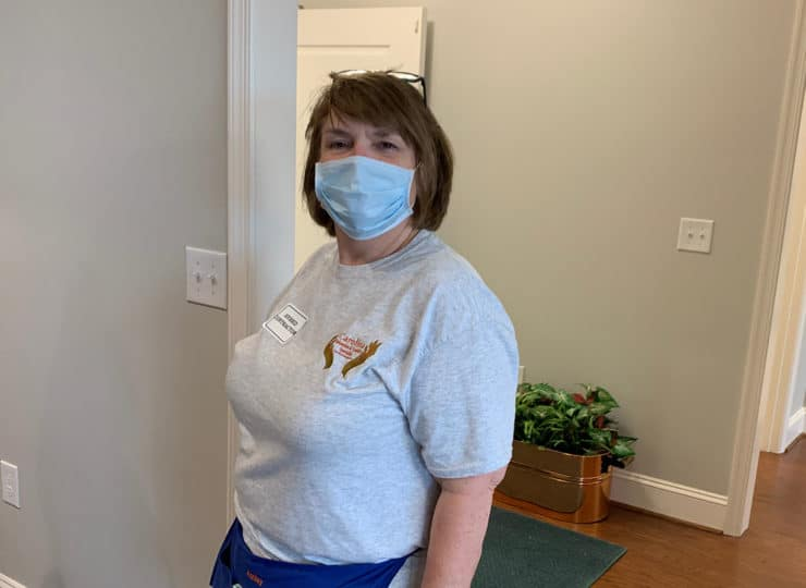 Carolina Relocation and Transition Specialists helper with mask