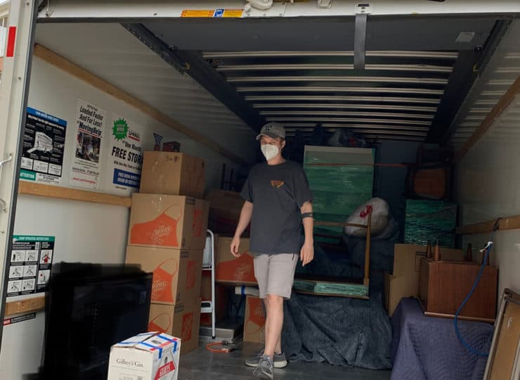 Carolina Relocation and Transition Specialists helper in truck