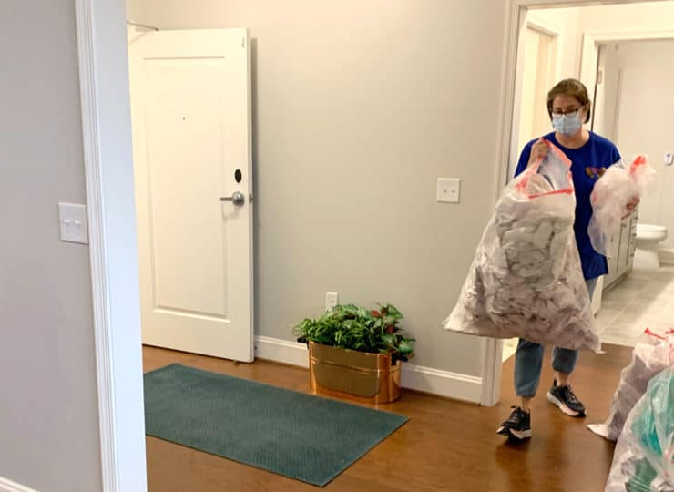 Carolina Relocation and Transition Specialists helper with bags