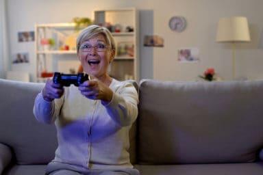 Senior woman playing video games
