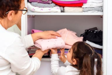 Senior and her granddaughter are decluttering her linens