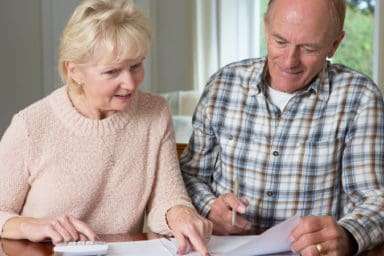 Senior couple figuring out their social security benefits
