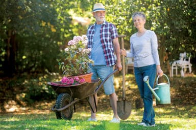 Vibrant Health Man and Lady Gardening