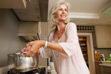 Senior about to have a cooking accident at home