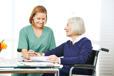 Senior with nurse at memory care center