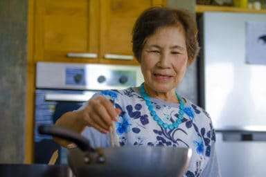 Senior woman cooking recipes for seniors