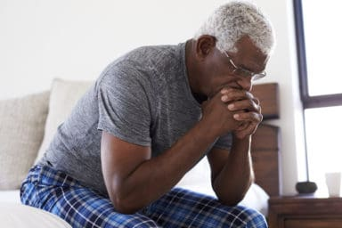 Senior man exhibiting signs of depression