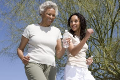 Mother and daughter jogging to get lower cholesterol