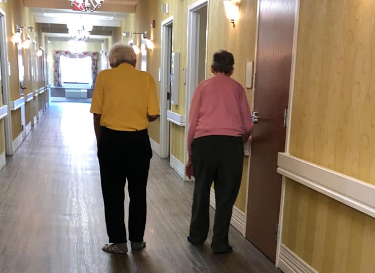 Alois Alzheimers Couple Walking In Hallway