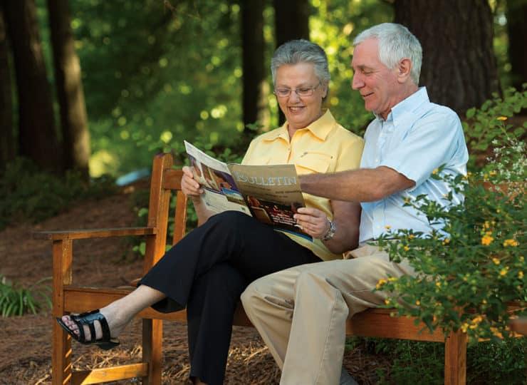 The Oaks At Whitaker Couple Outside Reading