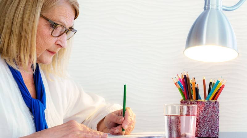 Senior woman coloring knows the benefits of creativity for seniors