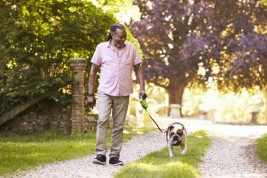 Man enjoying the benefits of dogs for seniors