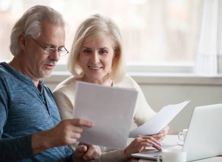 couple reading paperwork