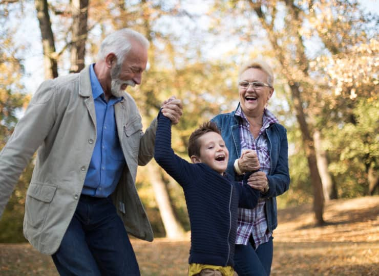 Grandparents with grandchild outdoors