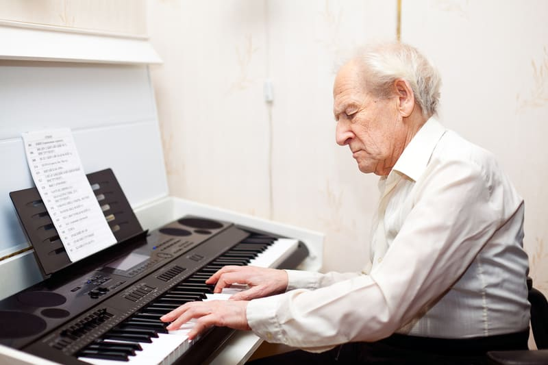 Creativity for seniors is important, like this man playing piano