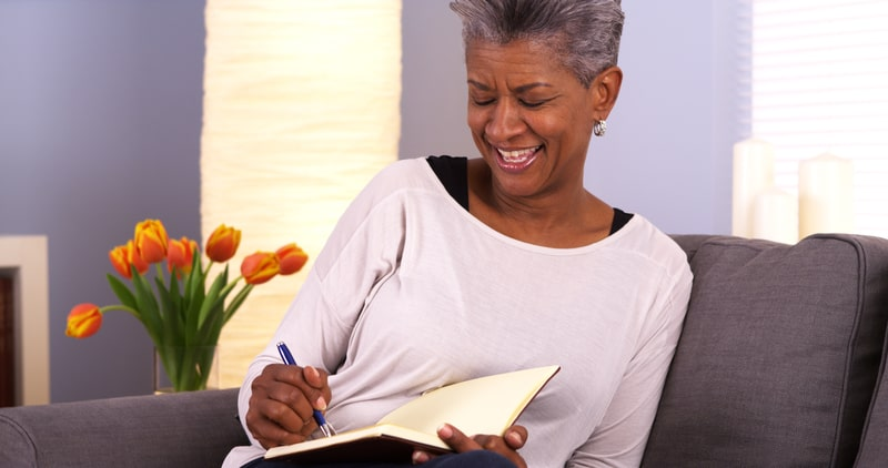 Woman journaling to get more creativity for seniors