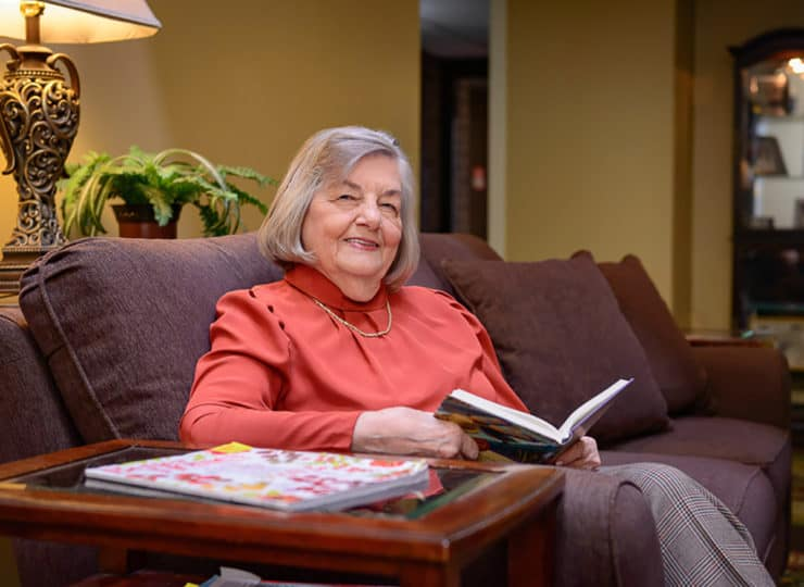 Mayfair Village Retirement Center Lady Reading Book