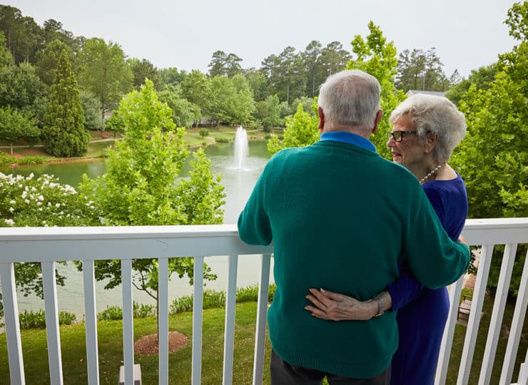 Woodland Terrace Cary Couple Overlooking Fountain On Balcony