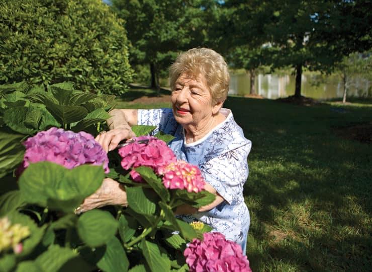 Woodland Terrace Cary Senior Lady Gardening