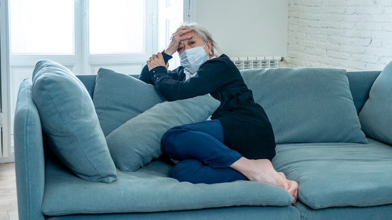 Senior woman suffering from seasonal affective disorder and COVID