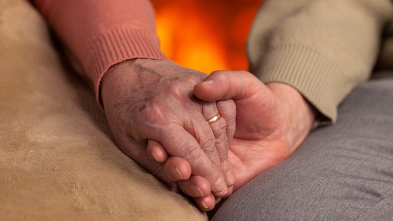 Someone facing weight changes in seniors by the fire