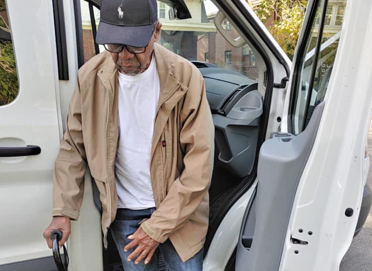 A List Cleaning and Transportation Man With Cane