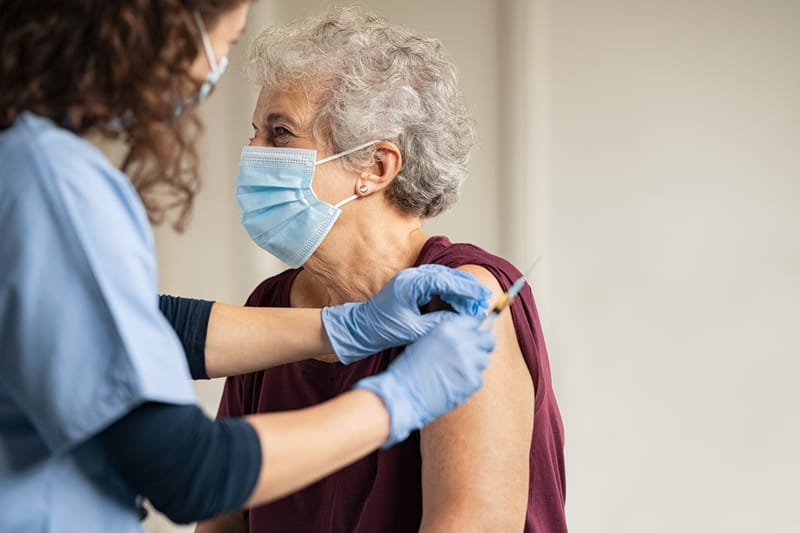 Woman receives a COVID vaccine for seniors